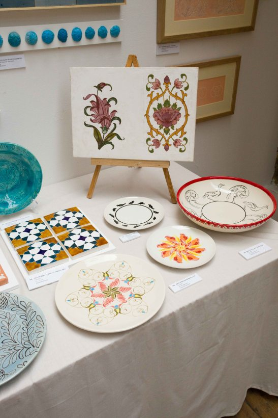 Hand painted ceramic plates and fresco.