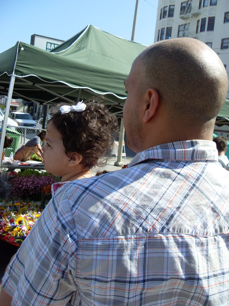 Father and baby at farmers market