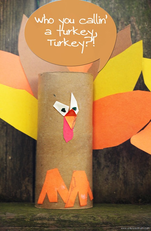 Turkey craft made out of empty toilet paper roll and construction paper.