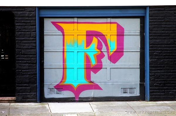 F painted on garage door in San Francisco