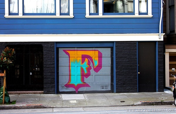 Garage door with an F painted on it