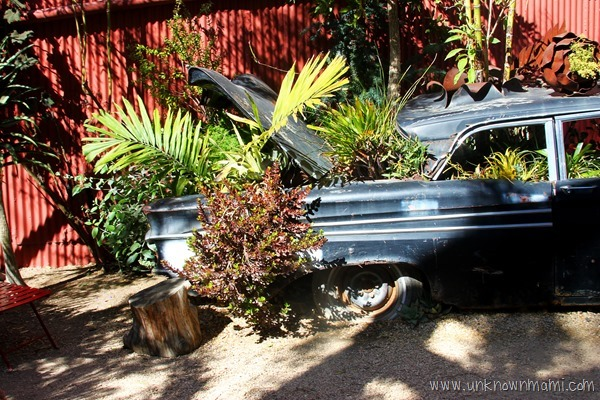 Car used as planter at Flora Grubb