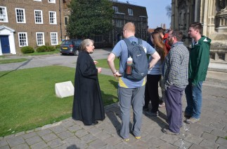 Canon Clare and pilgrims near the stone marking the beginning of the Via Francigena