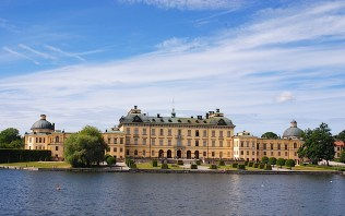 The 18th-century Drottningholm Palace sits on the shore of Lake Malar, Stockholm, Sweden. By C.S. White