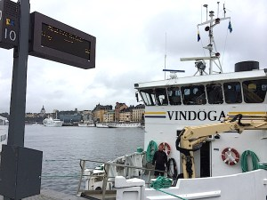 Under cloudy, gray skies, a docked ferry waits to take Stockholm's midsummer revelers to Vaxholm, Sweden.