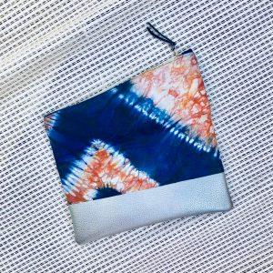 African tie-dye batik bazin cloth fold over zipper ethnic clutch from Tribal Marks by 'Dami - open
