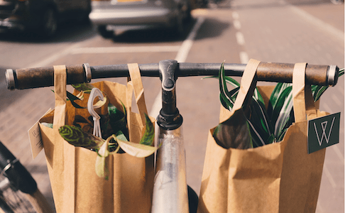 a bike delivering groceries. grocery delivery is efficient home management.