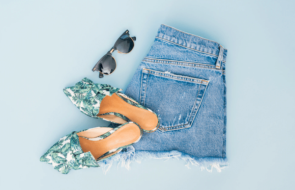 jeans, shoes and sunglasses to signify your bach party packing list.