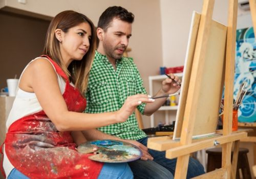a couple having paint night which is fun activities for couples