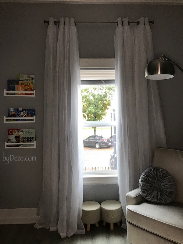 nursery window, curtains and books