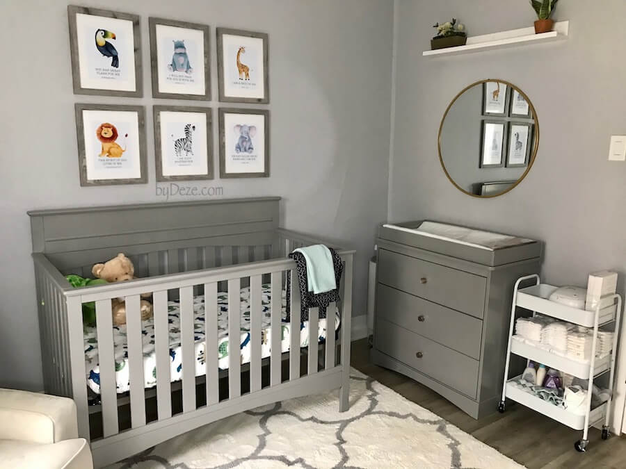 small, gender neutral nursery with crib, changing table and mirror