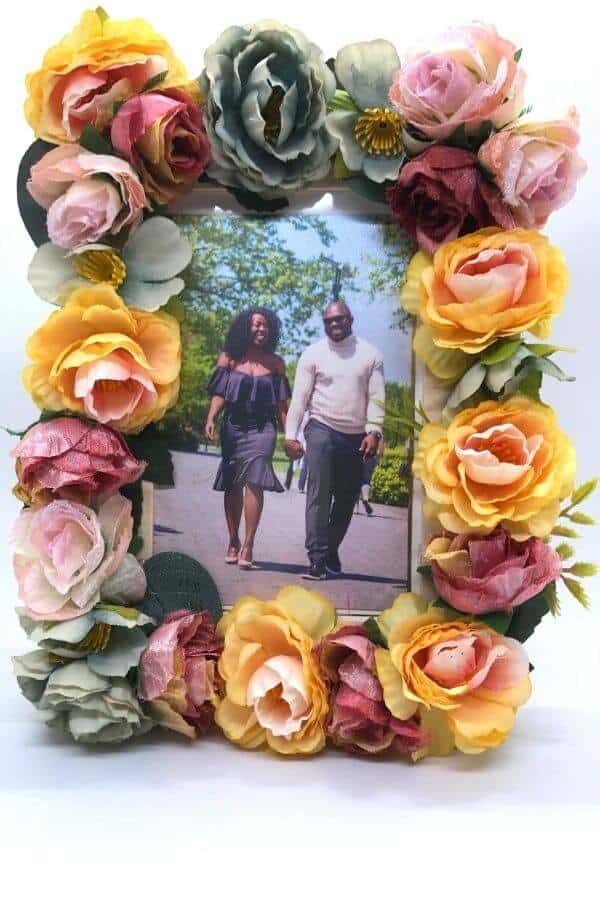 engagement photo in a diy picture frame with flowers