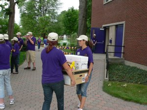 Residential advisors gather to help students move into the dorms.