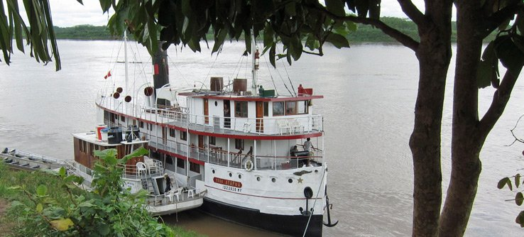 Eco travel with river boat in the Amazon