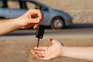 Photo of car owner returning car to the car lender