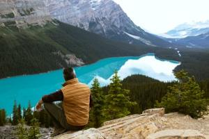 Person meditating on a mountain