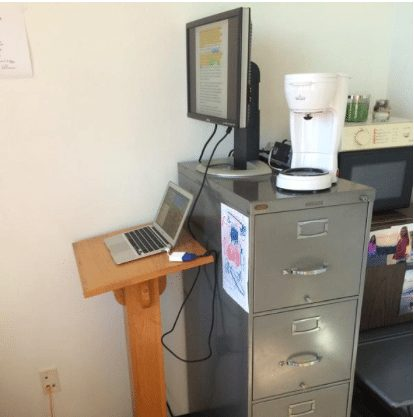 The recycled-podium-slash-filing-cabinet standing desk.