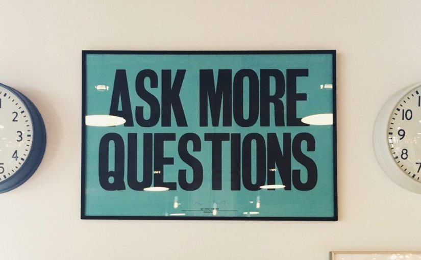 "A poster on a wall which says, ""Ask more questions"" from Nick Byrd's ""Research Questions & Substitution: A Warning"""