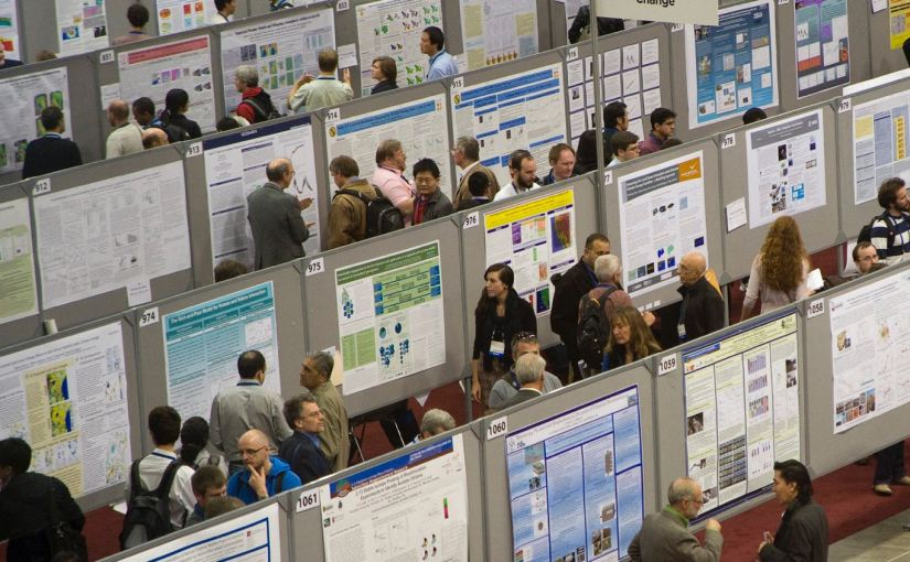 A picture of a large poster session at a conference.