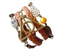 Brazalete lechuza, reliquias y snitch