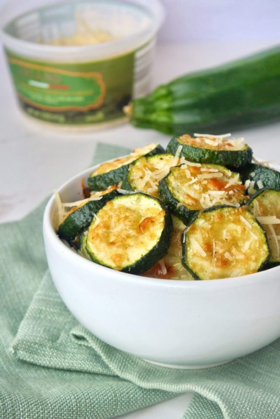 Roasted Garlic Parmesan Zucchini is what side dish dreams are made of. Fresh zucchini is topped with freshly shredded Parmesan cheese and baked to tender, golden perfection for a quick and easy side dish that might just end up becoming the main event! | www.bytesizednutrition.com