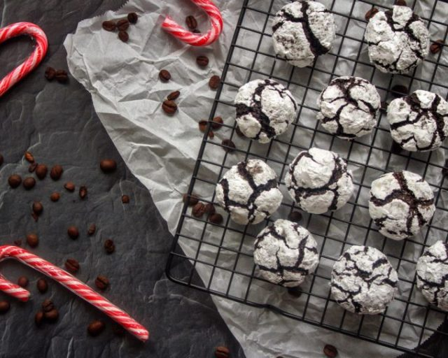 Peppermint Mocha Crinkle Cookies are a fun, festive, and delicious addition to your holiday baking lineup. These tender, chewy, brownie-like cookies are dusted in powdered sugar and infused with peppermint and coffee flavors for a show-stopping holiday treat!   www.bytesizednutrition.com