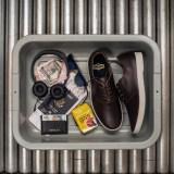 austyn_airport_shoes_in_bin_web
