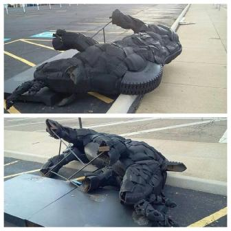 Rhinoceros Sculpture Canton  Arts District damaged