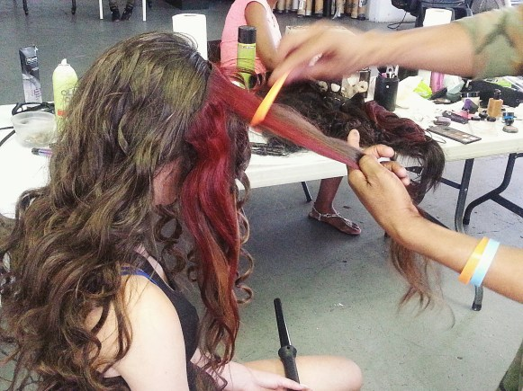 Model Skylar getting hair pieces