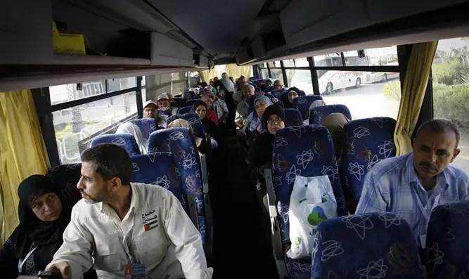 Gaza residents in bus leaving crossing