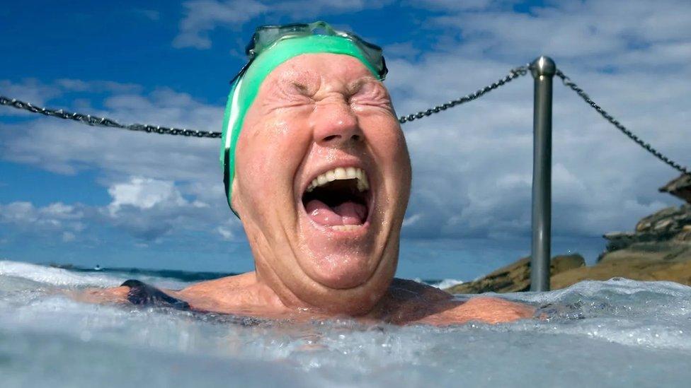 Senior woman enjoying a hot pool.