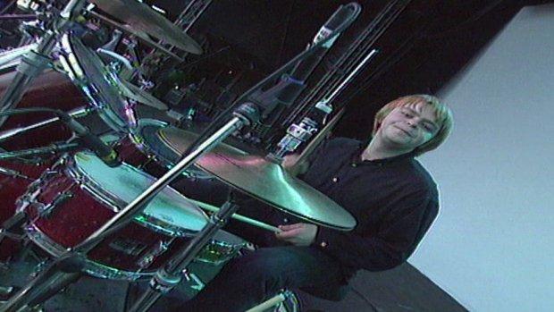 Carl Bevan playing drums