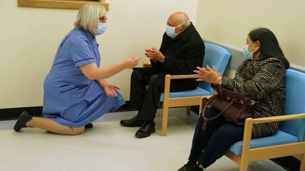 Retired nurse Suzanne Medows (left) speaks to race relations campaigner Dr Hari Shukla, 87, and his wife Ranju before he receives the first of two Pfizer/BioNTech Covid-19 vaccine jabs at the Royal Victoria Infirmary in Newcastle