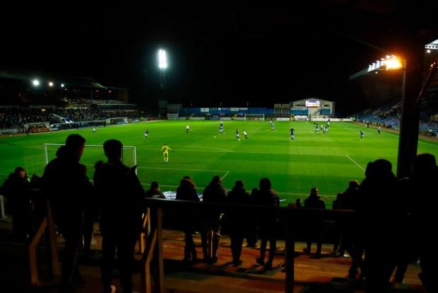 Carlisle United fans watch as their team plays Salford City