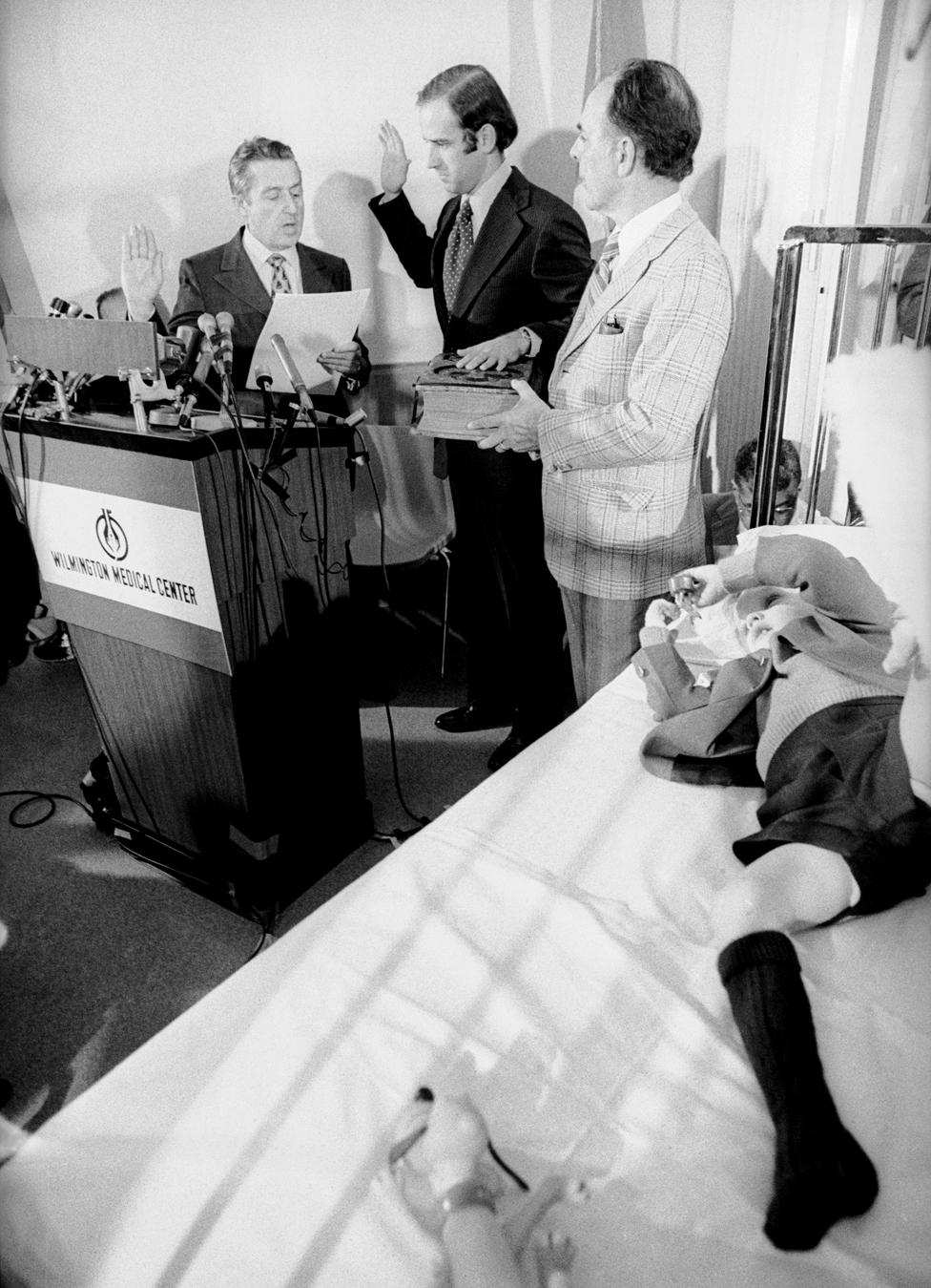 Senator Joseph Biden takes the oath of office in a hospital room