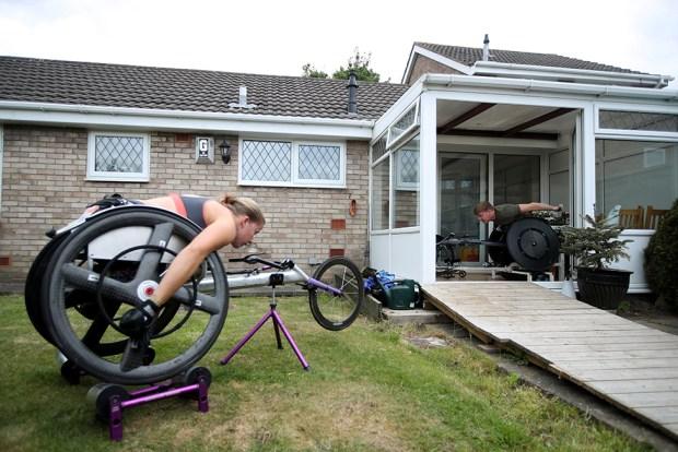 Two wheelchair athletes train outside their homes