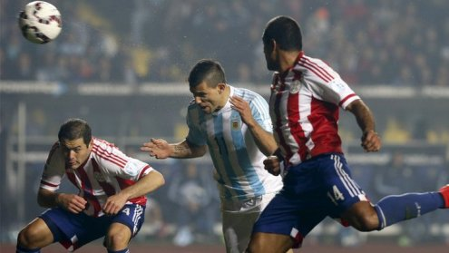Sergio Aguero heads in Argentina's fifth against Paraguay
