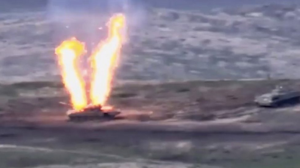 A still from handout video by Armenia's defence ministry shows what Armenia says is a destroyed Azerbaijani tank