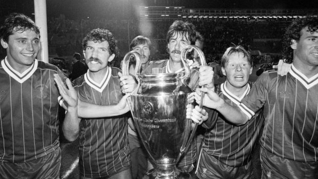 1984 European Cup Final at Stadio Olimpico, Rome. Liverpool 1-1 As Roma. Liverpool won 4-2 on penalties. Liverpool players left to right: Michael Robinson, Graeme Souness, Mark Lawrenson, Sammy Lee and Craig Johnston celebrate with the trophy on a lap of honour after the match, 30th May 1984.