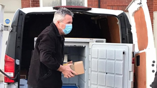 The vaccine being carried in a carboard box