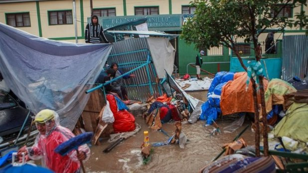 People recover their belongings during flooding caused by heavy rains in Sucre, Bolivia January 4, 2021.