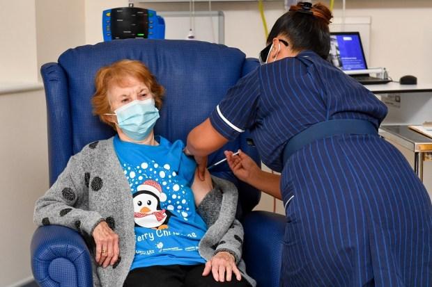 Margaret Keenan receives a coronavirus vaccine from a nurse