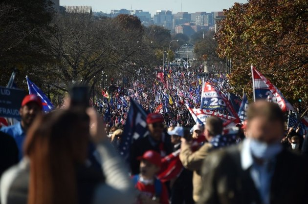 Supporters of US President Donald Trump march during a rally in Washington, DC, on 14 November 2020