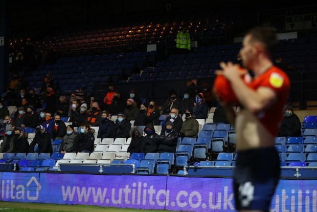 Fans look on from the stands during the match between Luton Town and Norwich City at Kenilworth Road