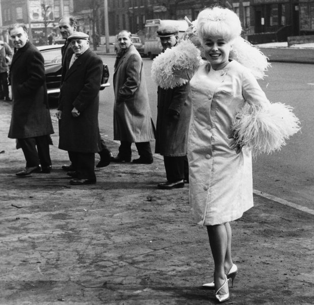 Attracting attention outside ABC Theatre in Mile End, east London, in 1963