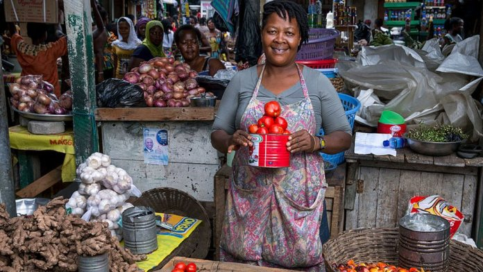 A vegetable trader at Circle market in Accra, Ghana - August 2015