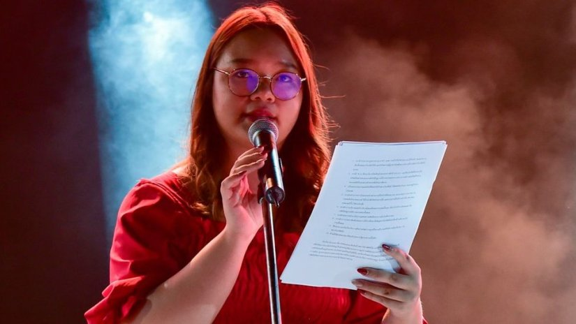 Student Union of Thailand spokesperson Panusaya Sithijirawattanakul reads a list of demands