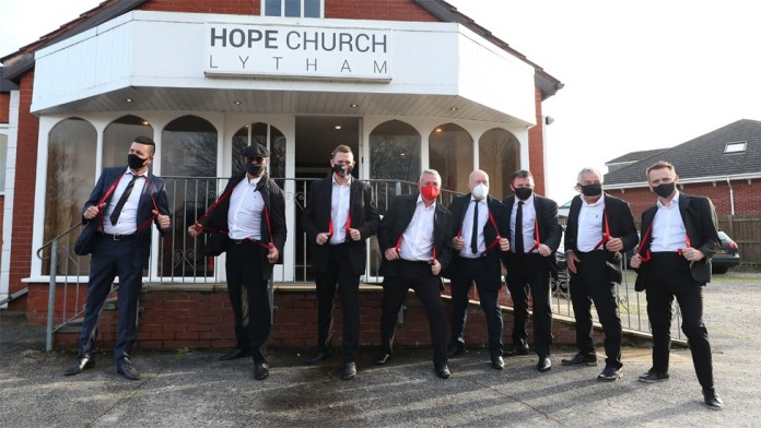 Mourners wearing red braces in honour of comedian Bobby Ball outside Hope Church in Lytham Saint Annes