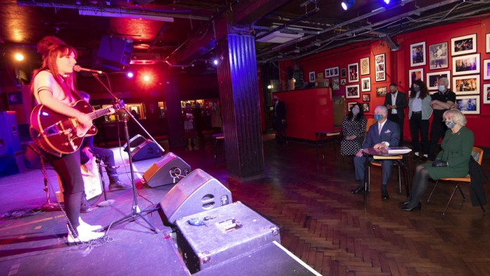 Charles and Camilla watching Emily Capell at the 100 Club