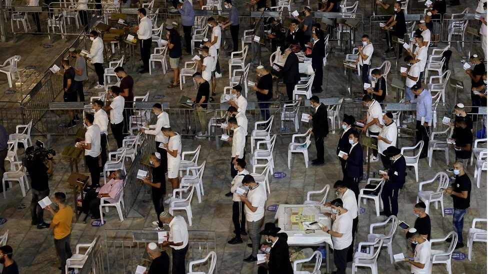Religious Jews keep social distancing inside dividing cells while participating in the Slichot (forgiveness) prayer, the last prayer on the eve of Rosh Hashana, the Jewish New year, at the Western Wall in the old city of Jerusalem, on 18 September 2020.